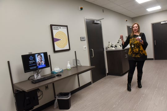Dr. Shannon Cabrera talks about the staff areas Tuesday, Oct. 16, at the newly-renovated CentraCare Eye Clinic in Sartell.