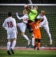 Tech goaltender Christian Engel leaps for the ball during the first half of the Tuesday, Oct. 16, game at Husky Stadium in St. Cloud.