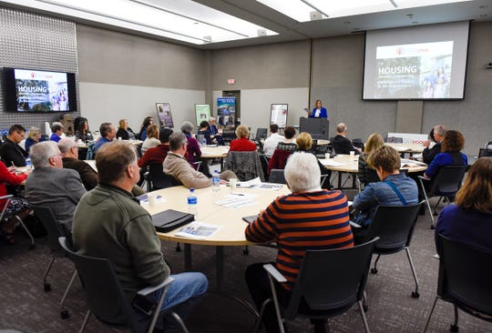 Karen Burzette, Central Minnesota Housing Coordinator with CentraCare Health and United Way of Central Minnesota, talks with local leaders during a discussion Tuesday, Oct. 16, on affordable housing.