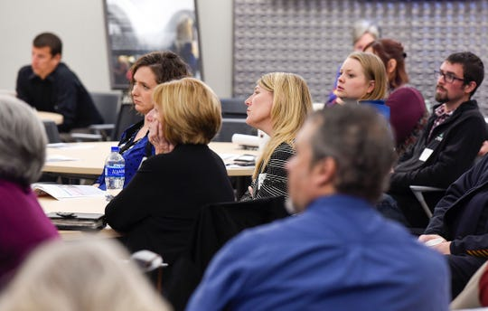 Area leaders listen to the discussion on affordable housing Tuesday, Oct. 16, at CentraCare South Point in St. Cloud.