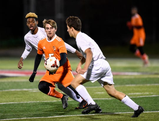 Tech's Ethan Miller works against Maple Grove players during the first half of the Tuesday, Oct. 16, game at Husky Stadium in St. Cloud.