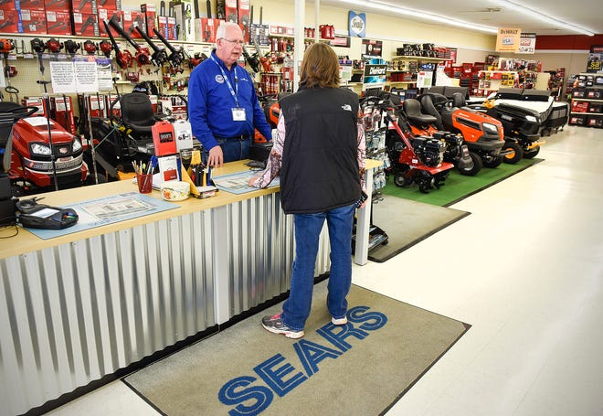 Dan Drilling, owner of the Sears Hometown and Outlet store, helps a customer Thursday, Oct. 12, 2017, in Little Falls.
