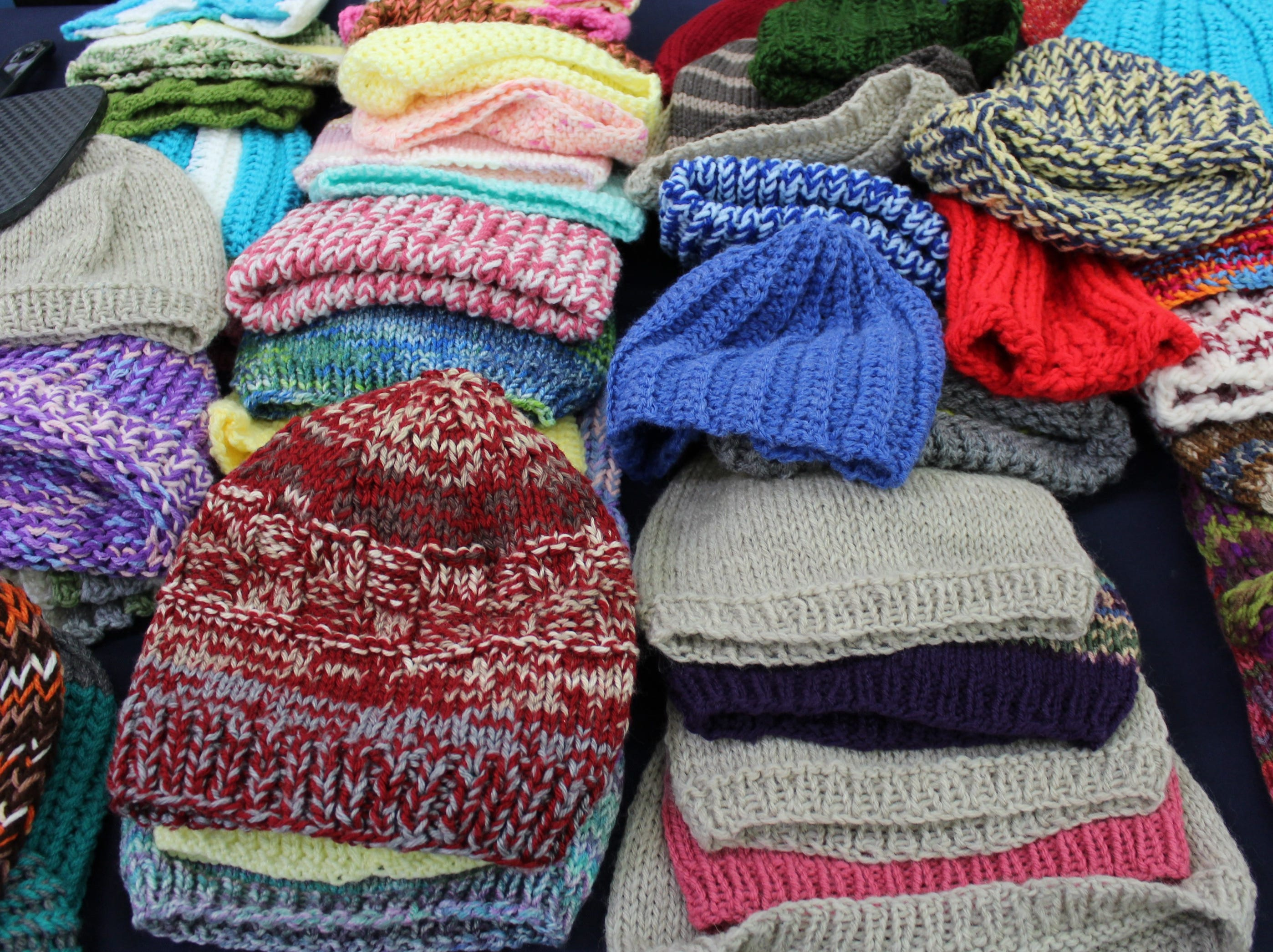 A collection of hand-knitted hats is on display during Operation School Bell, a program that provides kids in need with school attire, on Oct. 16, 2018.