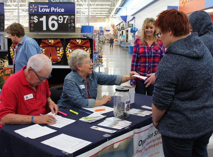 Beverly Sands gives instructions to two student shoppers during Operation School Bell in Hurricane on Oct. 16, 2018. Water Canyon High School counselor Wendee Wilkinson looks on.