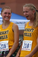 Desert Hills' Samantha Nelson (left) and Bailey Brinkerhoff celebrate their top 5 finishes at the 4A cross country meet in Salt Lake City on Oct. 17, 2018.