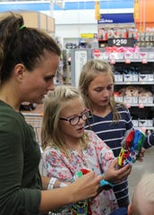 Tomi Durham and daughters Sydney and Demi hold a serious discussion on sock stylings during Operation School Bell in Hurricane Oct. 16, 2018.