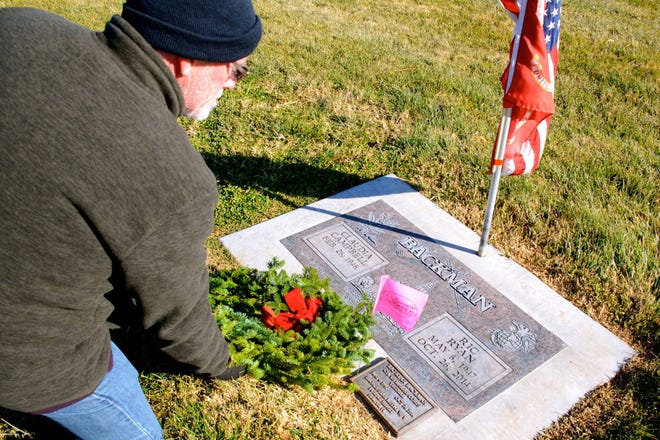Steven King places a wreath at the grave of his friend, veteran Ric Backman, in this submitted photo from Wreaths Across America.