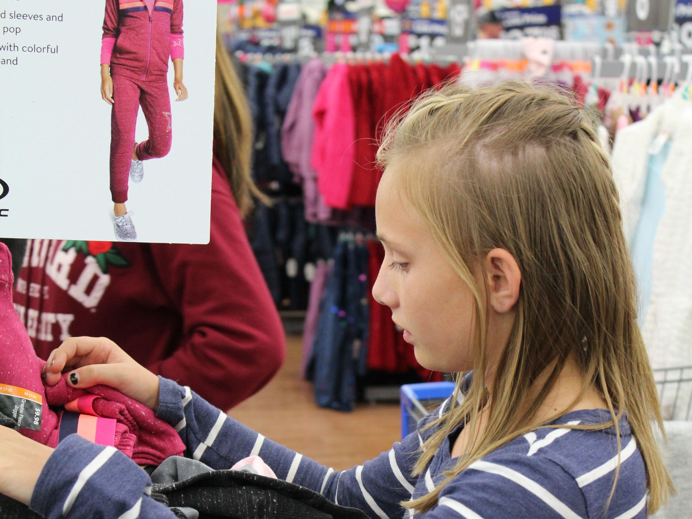 Demi Durham searches for her size during a school shopping spree in Hurricane on Oct. 16, 2018.