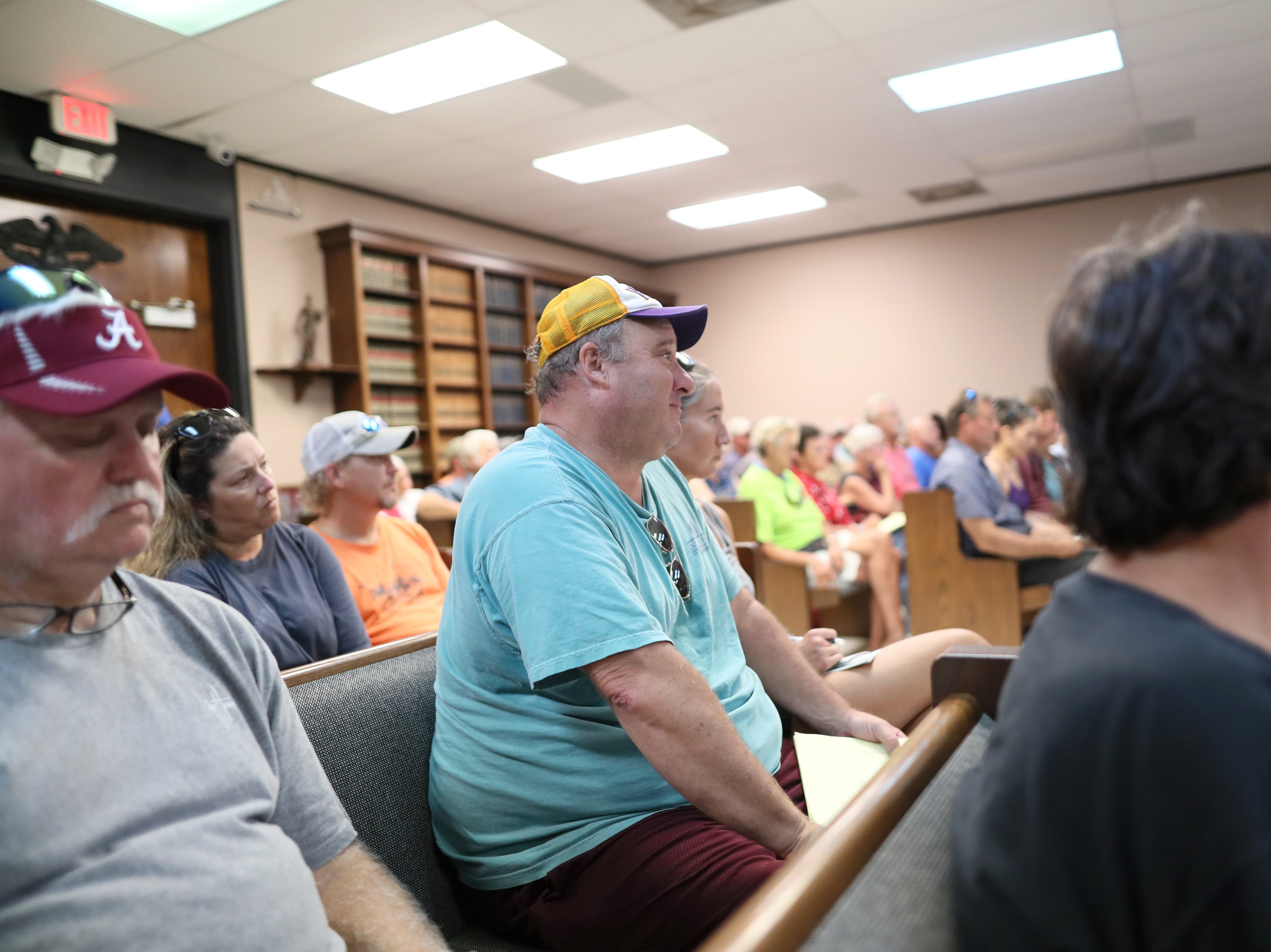 Local business owners sit inside Port St. Joe's county courthouse Tuesday, where state and city officials were sharing plans for disaster relief loans after the town was devastated by Hurricane Michael.