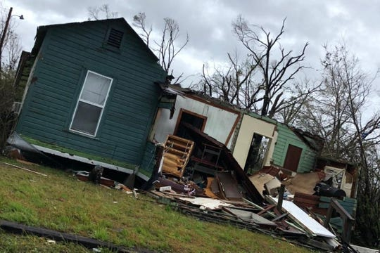 An exterior look at the damage to Janarius Robinson's house.