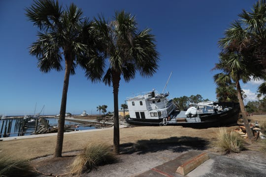 A boat lays ashore Tuesday near the Port St. Joe marina after Hurricane Michael blasted the region.