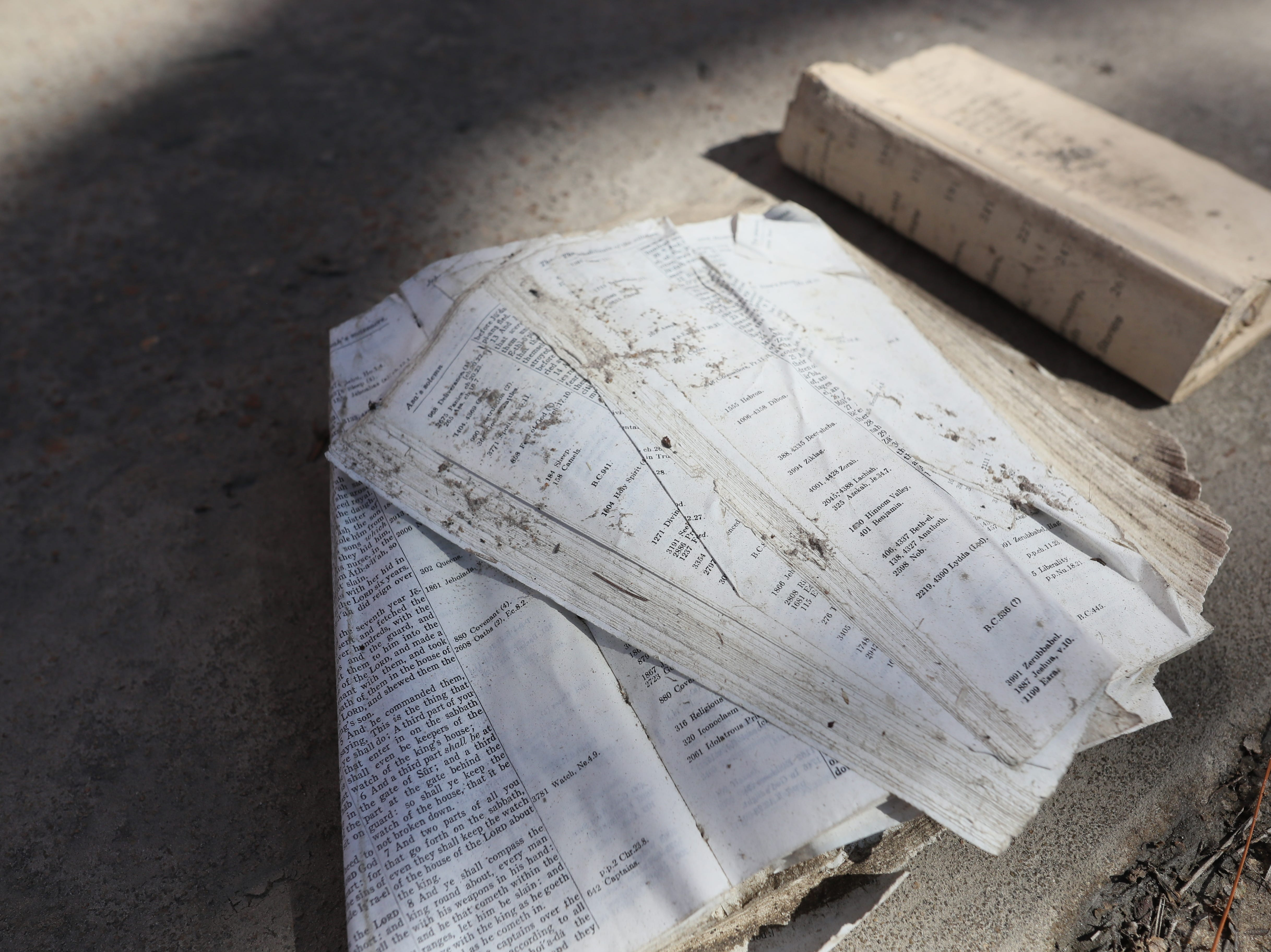 A bible lays tattered outside the First United Methodist Church in Port St. Joe on Tuesday, Oct. 16, 2018. The church was pummeled by Hurricane Michael, leaving both the sanctuary and the pastor's house in shambles.