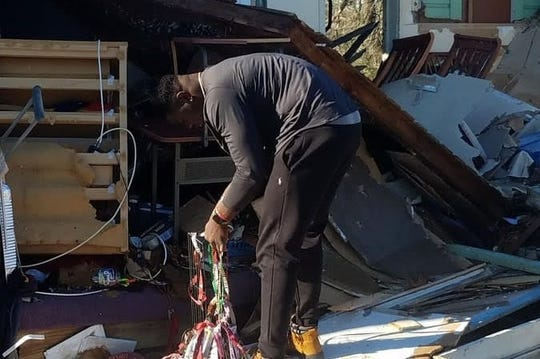 FSU defensive end Janarius Robinson examining the remains of his Panama City house in the wake of Hurricane Michael.