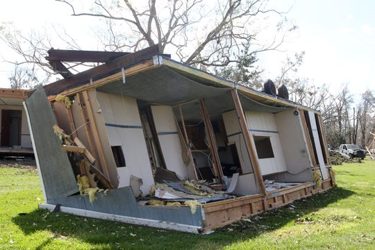 A mobile home in Grand Ridge is flipped upside and torn apart after Hurricane Michael struck.