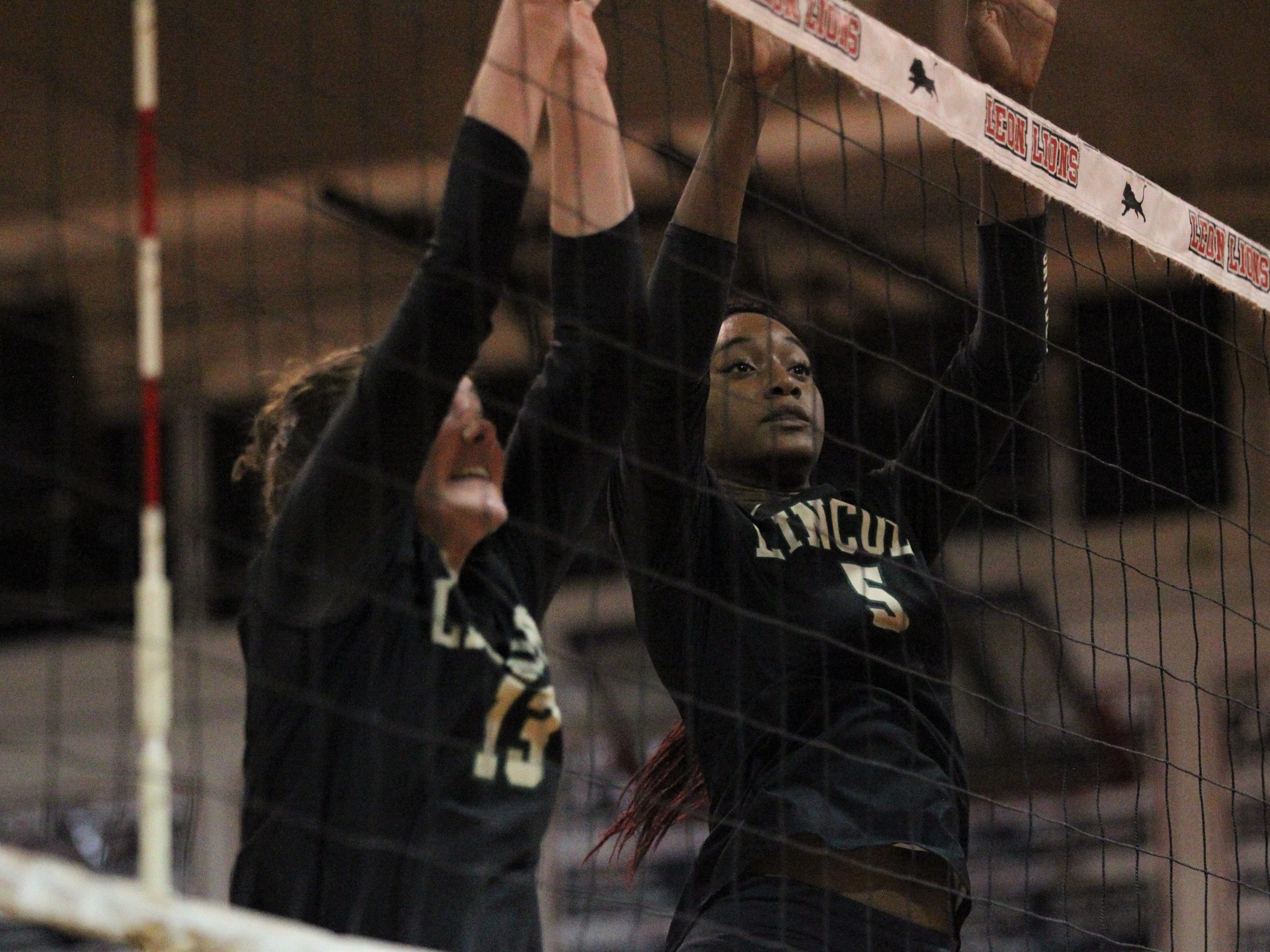 Lincoln's Khori Louis (5) and Loren Scott (13) try to get a block. Chiles beat Lincoln 3-0 in a District 2-8A semifinal on Tuesday at Leon.