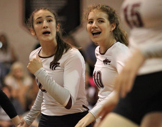 Chiles' Anna Corry and Peyton Elebash (10) react to scoring a point as the Timberwolves beat Lincoln 3-0 in a District 2-8A semifinal on Tuesday at Leon.