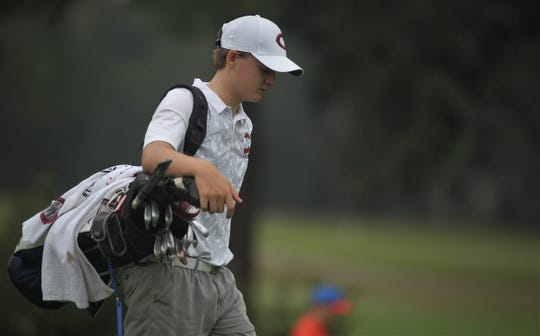 Chiles freshman Parker Bell walks towards a green during the District 1-3A boys golf tournament at Hilaman Golf Course.