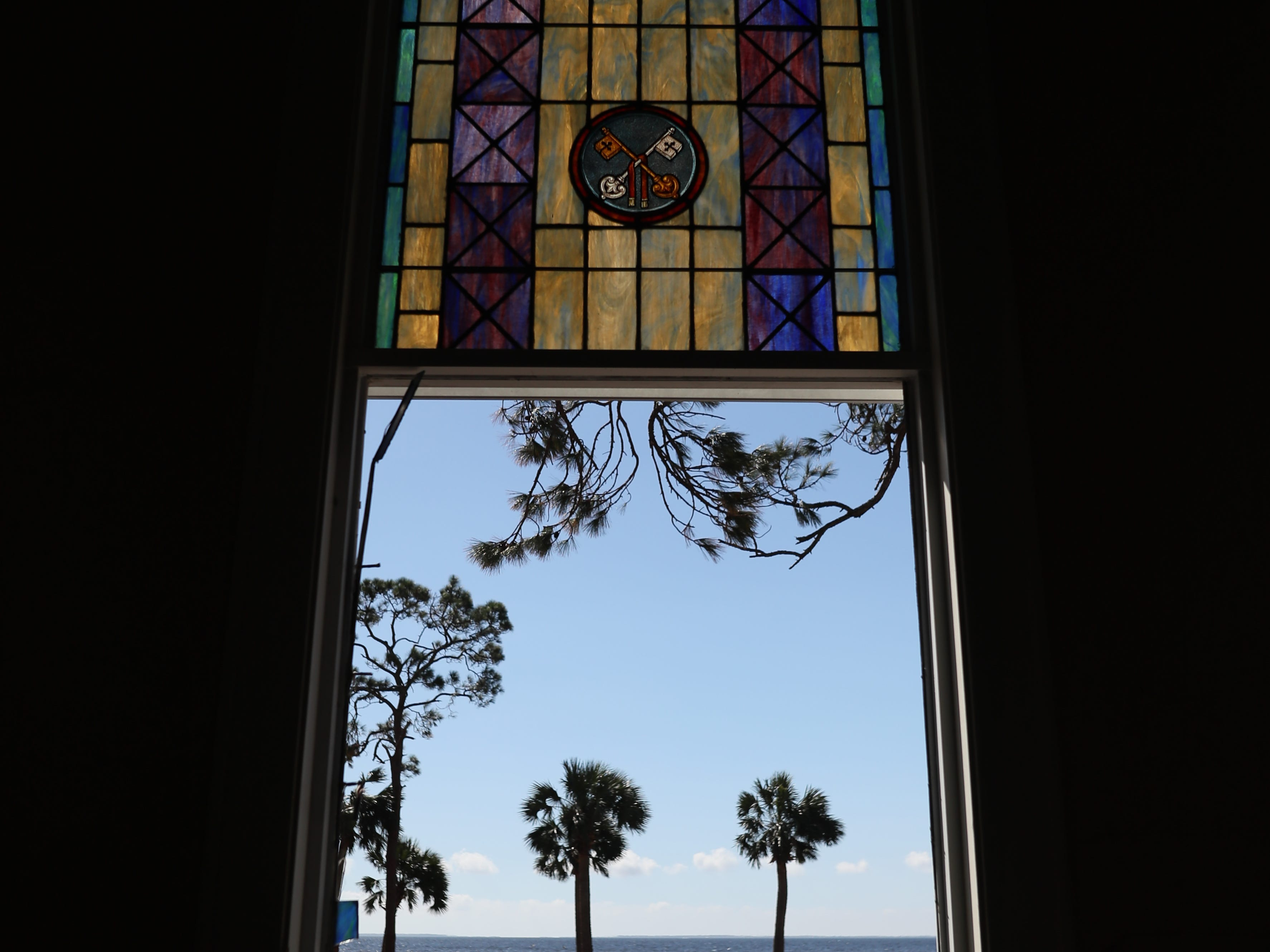 A scenic, coastal view of the Gulf of Mexico calmly beckons outside of the First United Methodist Church in Port St. Joe on Tuesday, Oct. 16, 2018. The church was battered by Hurricane Michael, leaving both the sanctuary and the pastor Geoffrey Lentz's house in shambles.