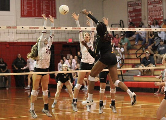 Lincoln's Khori Louis goes for a kill past Chiles' block, but Chiles beat Lincoln 3-0 in a District 2-8A semifinal on Tuesday at Leon.