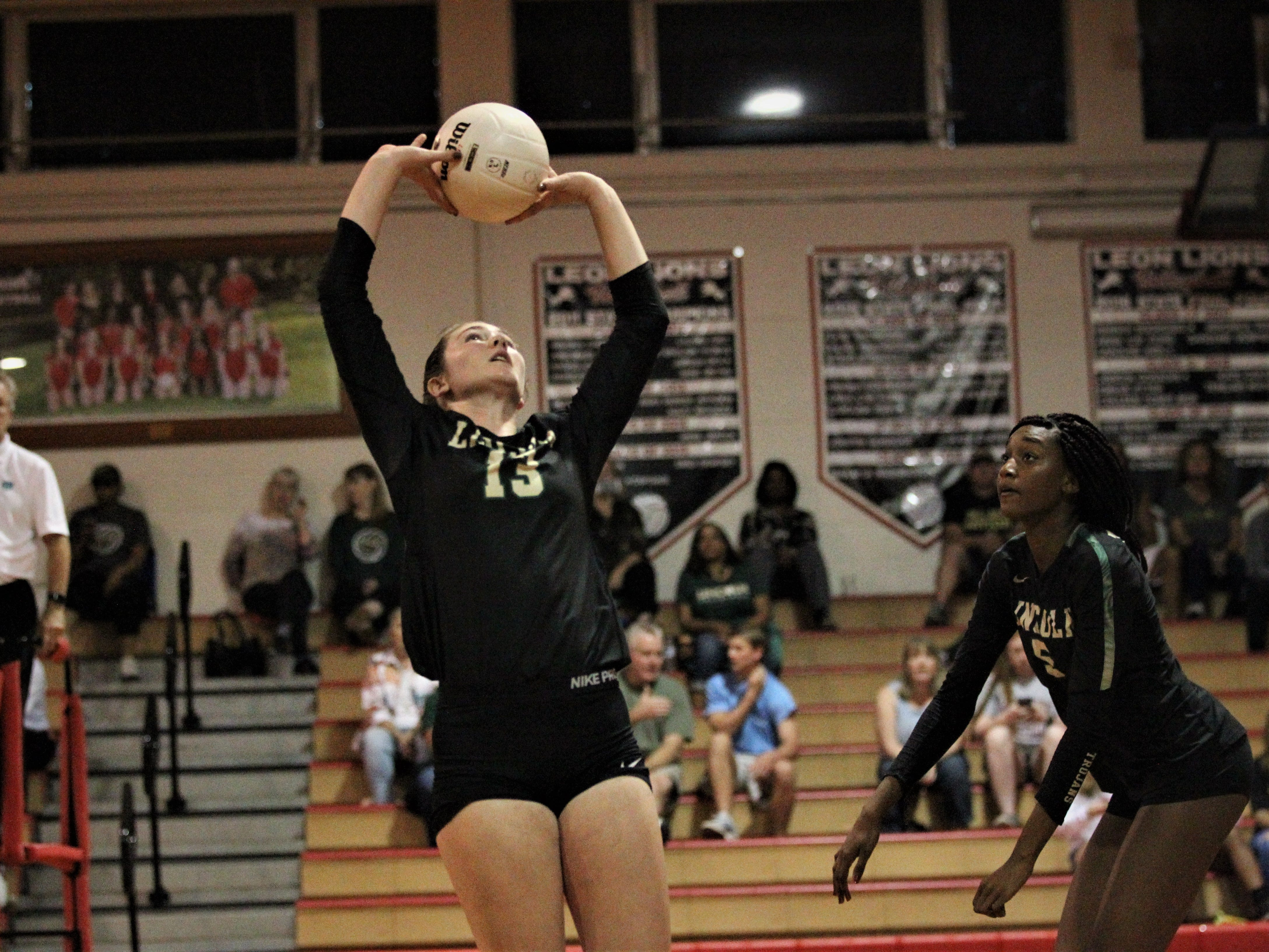 Lincoln senior setter Loren Scott sets a ball for Khori Louis. Chiles beat Lincoln 3-0 in a District 2-8A semifinal on Tuesday at Leon.