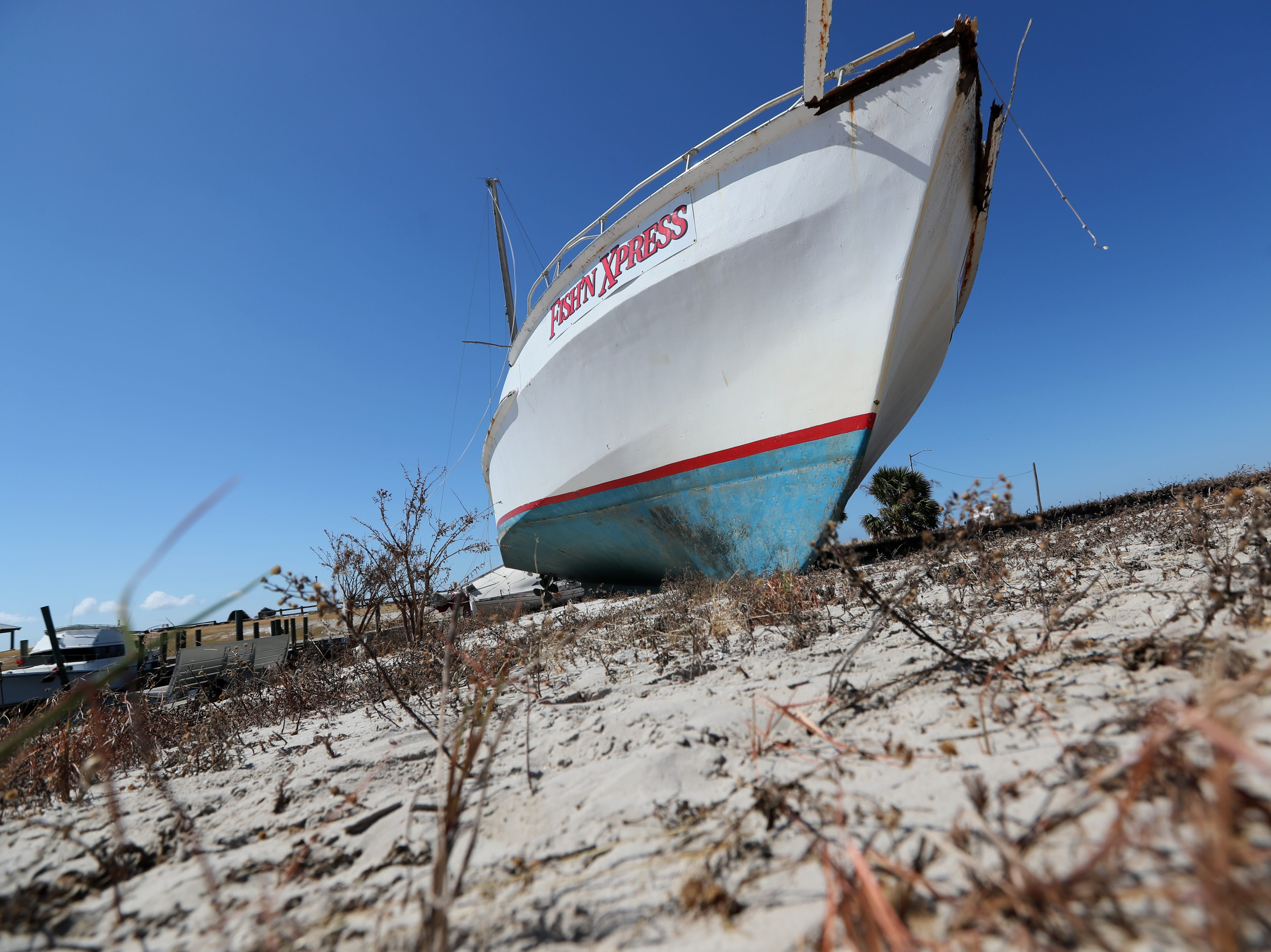 Fish'N Xpress, a large fishing vessel lays ashore Tuesday near the Port St. Joe marina after Hurricane Michael blasted the region.