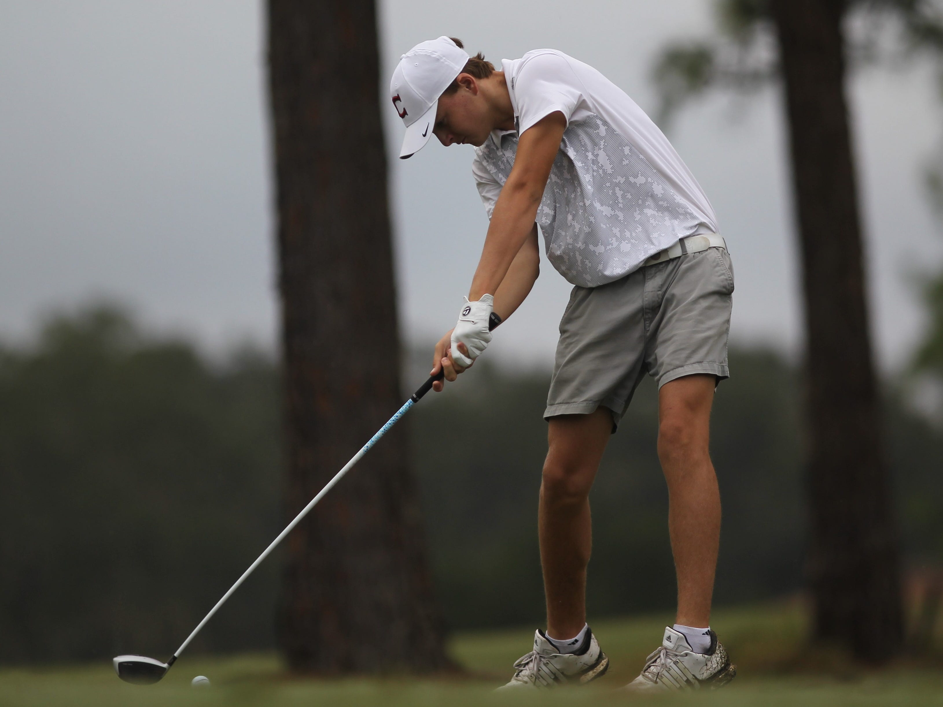 Chiles freshman Parker Bell tees off during the District 1-3A boys golf tournament at Hilaman Golf Course. Bell won with a 2-under par 70.
