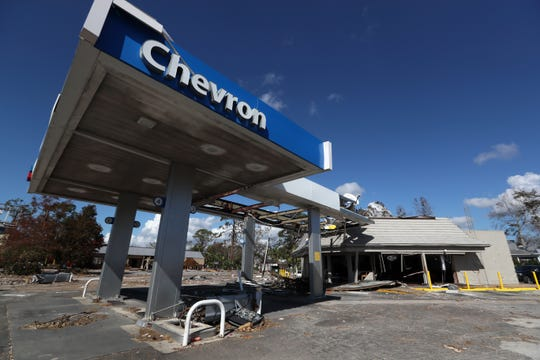 The Chevron gas station in Port St. Joe is left completely destroyed on Tuesday, Oct. 16, 2018 after Hurricane Michael passed through the coastal Florida town six days earlier. The station is one of only two in the city, both of which were left in shambles and remain closed.