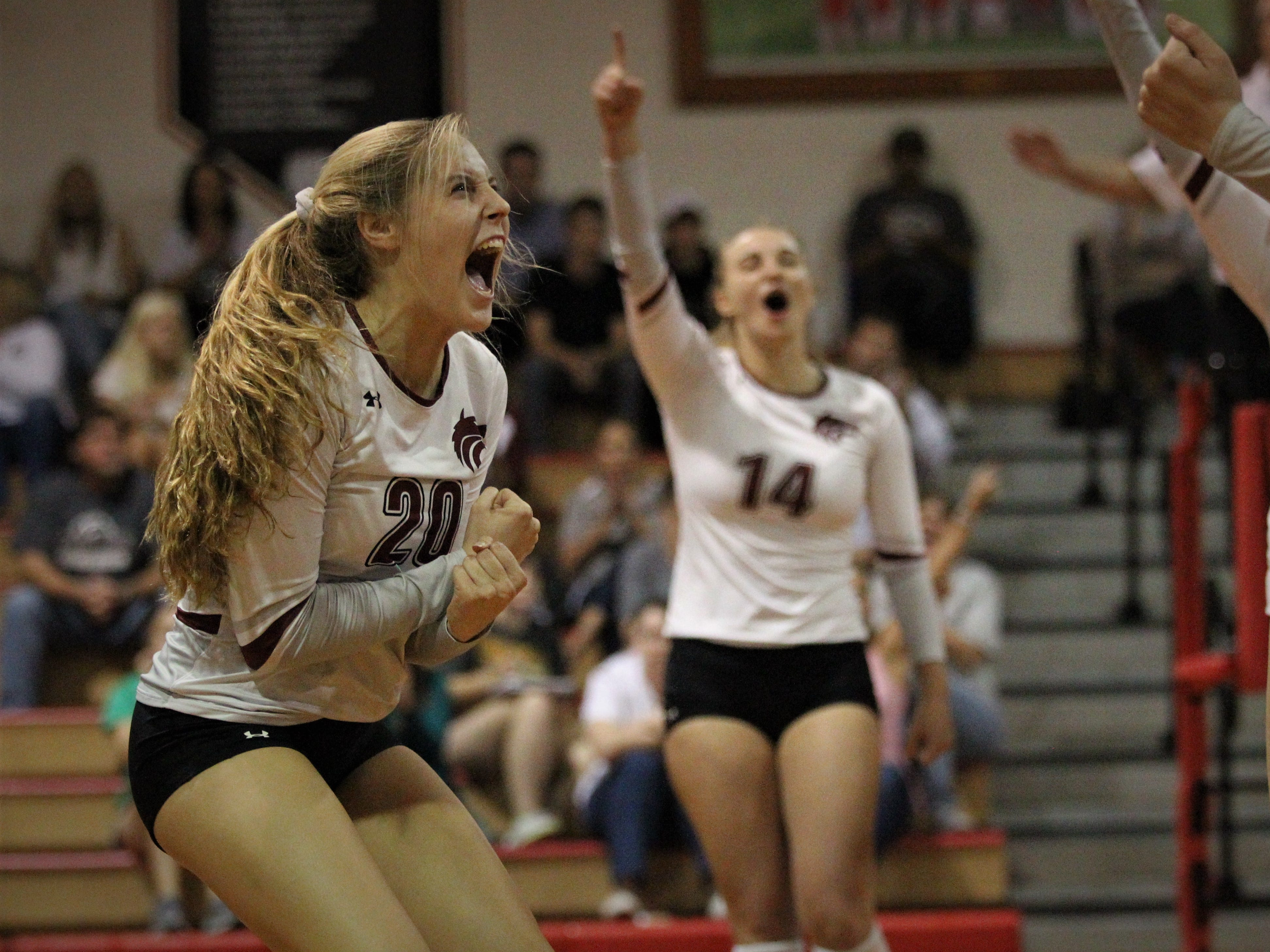 Chiles seniors Kelsey Mead (20) and Aly Freeland (14) react to scoring a point as the Timberwolves beat Lincoln 3-0 in a District 2-8A semifinal on Tuesday at Leon.
