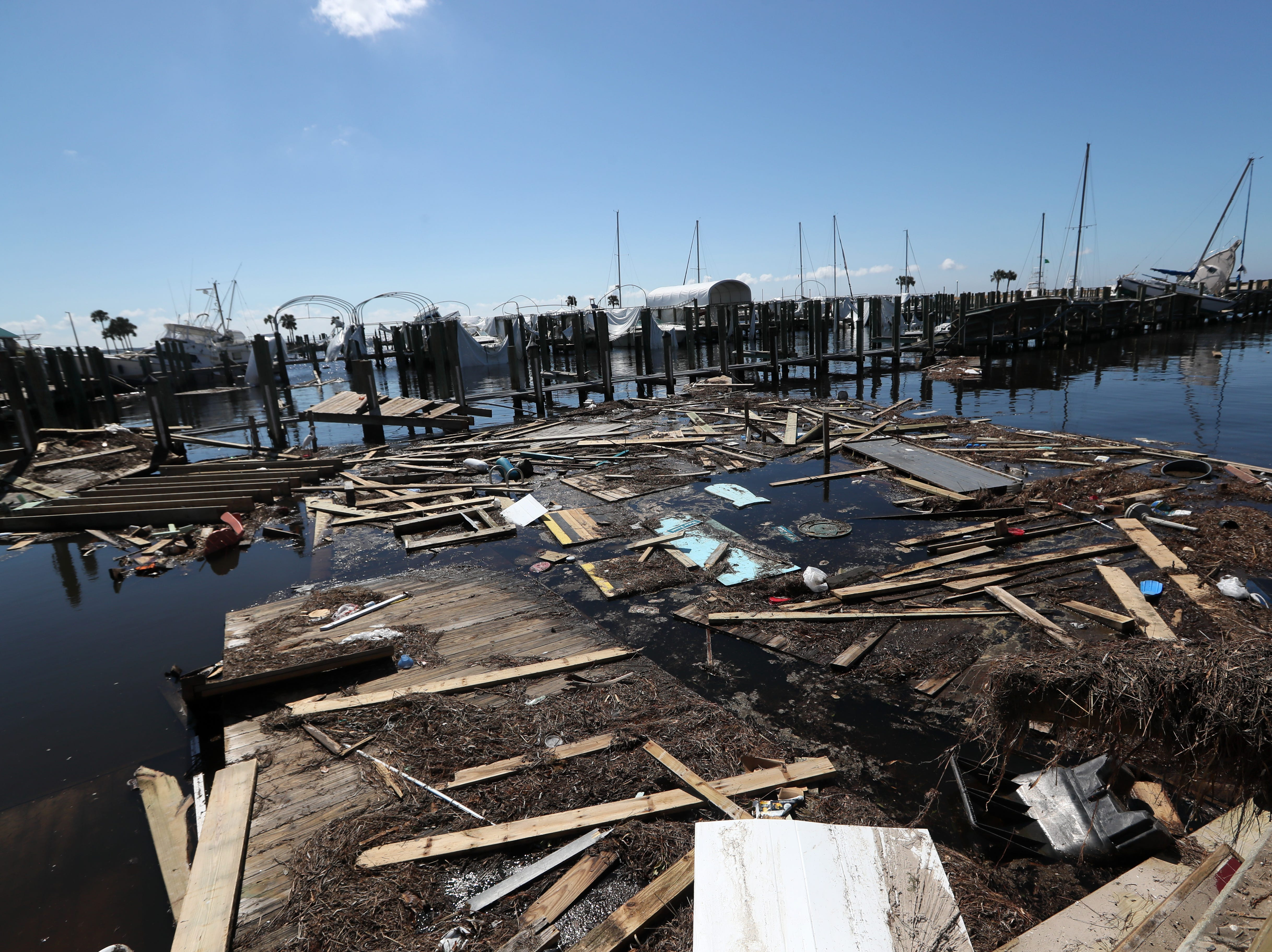 Debris floats along the water Tuesday in the Port St. Joe marina after Hurricane Michael blasted the region.