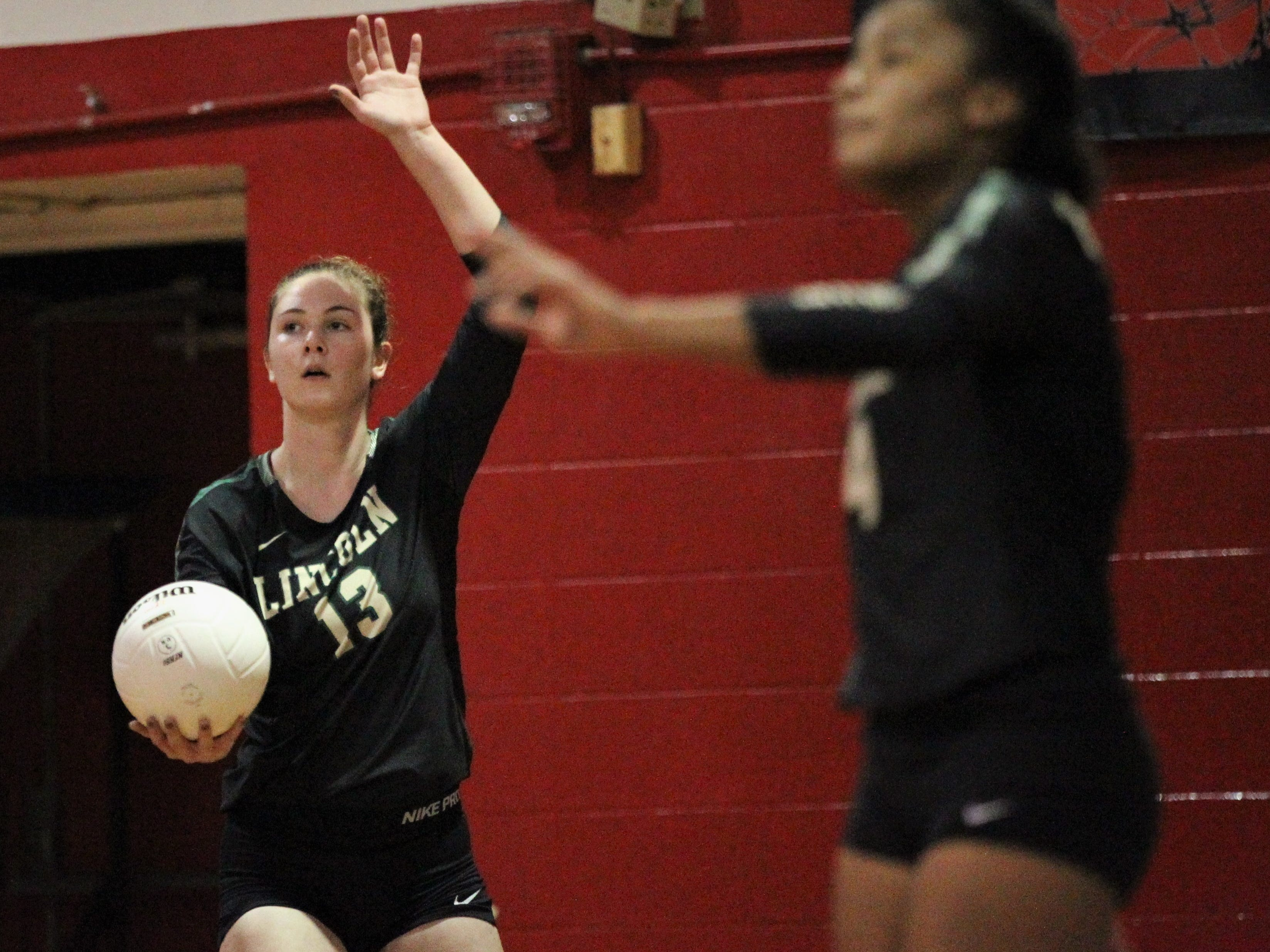 Lincoln senior Loren Scott serves as Chiles beat Lincoln 3-0 in a District 2-8A semifinal on Tuesday at Leon.