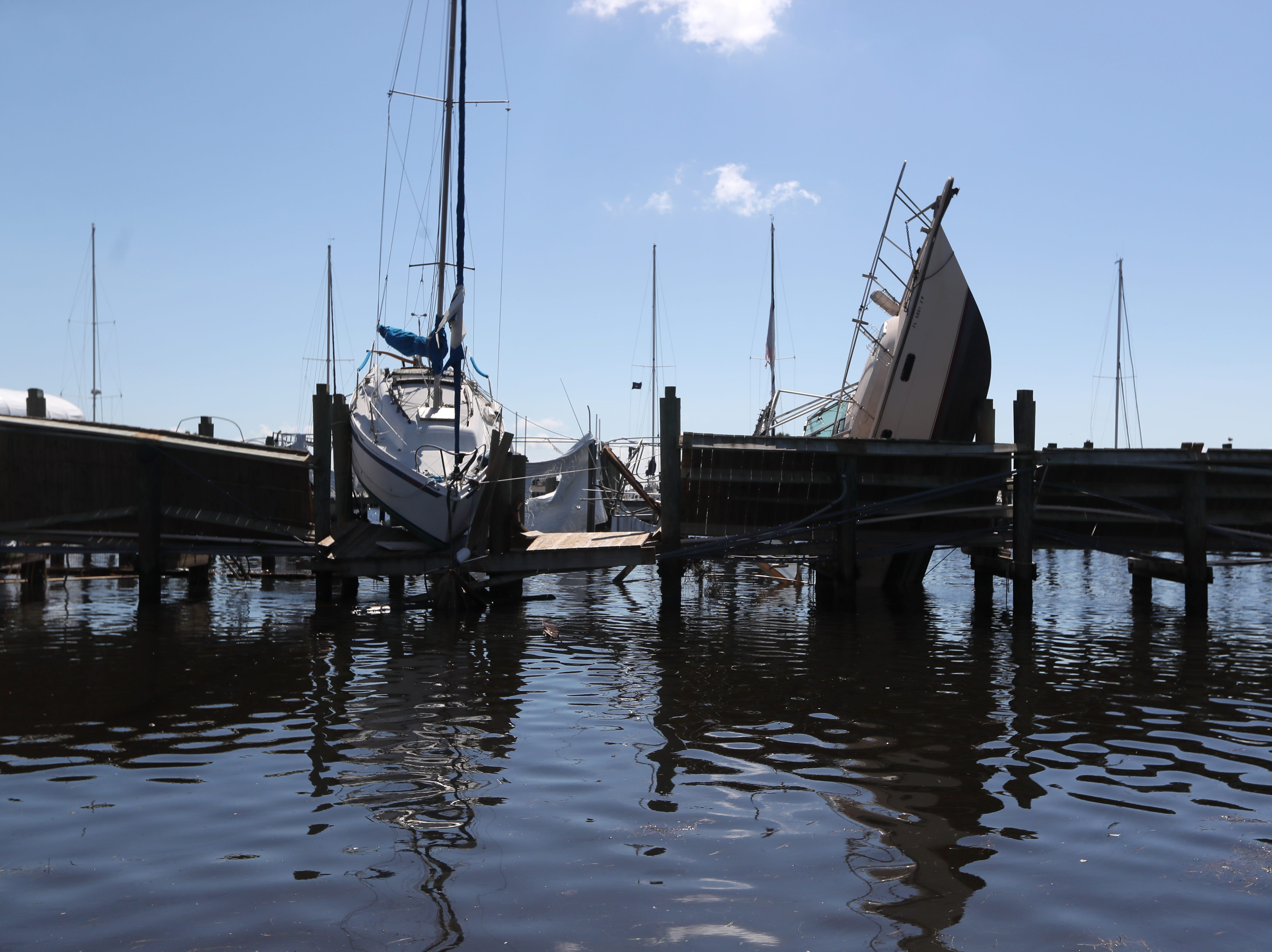 Boats are twisted along the docks Tuesday in the Port St. Joe marina after Hurricane Michael blasted the region.