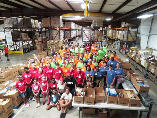 Pack The House's final shift of volunteers finished up preparing the meal boxes at the 2017 event.