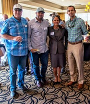 Jacqui Thurlow-Lippisch is flanked by Captains for Clean Water representatives Bob Beville, left, Chris Whitman and Leland Garland, right, at the Stuart Sunrise Rotary Water Forum.