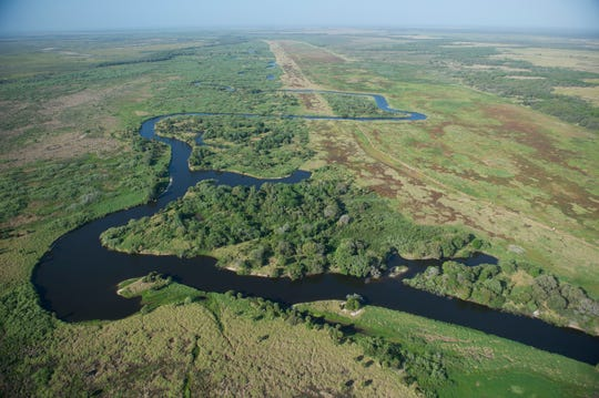 On a tour with the South Florida Water Management District, an aerial view of the Kissimmee River Restoration Project is seen on March 24, 2017, in central Florida. The Kissimmee River Restoration Project, a joint effort by the South Florida Water Management District and the U.S. Army Corps of Engineers, is a plan to reverse the effects of a channelization of the river done in the 1960s. The channel damaged the ecosystem of the winding natural river, though it helped prevent severe flooding.