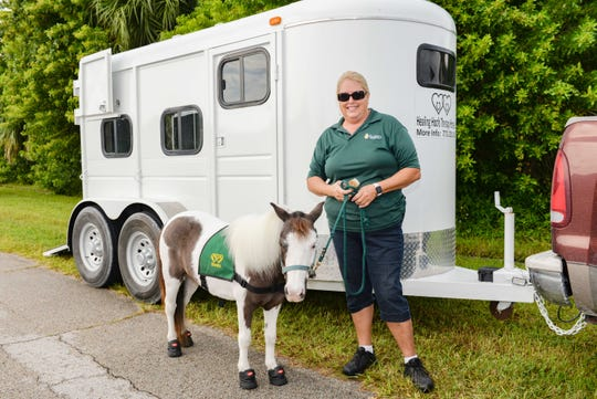 Barbara Neuman, manager and handler with Healing Hoofs Therapy Horses Inc. and Banks, a 9-year-old miniature horse, arrive at the Sunny Days Assisted Living Facility in Port St. Lucie.