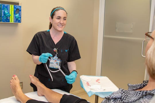 As a charge nurse at the David L. Smythe Wound Center in Stuart, Jessica Kelley oversees the clinic and treats patients who require aggressive wound care.