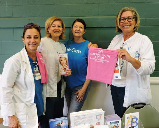 Diane Hoskins, left, Cathy Connelly, Diane Komara and Robin Adley of Martin Health Systems distributed breast cancer detection materials at the Martin County Community Health Fair.