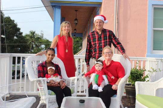 "Ashley and Steven Vitale, standing, owners of the Old Colorado Inn and Guest Cottages, with Mary's Shelter residents Wilmine, seated left, with her baby Kalani and Jessica with her baby Madison, invite you to join in the spirit of Christmas at ""We've Made Room at the Inn"" on Dec. 8-9."