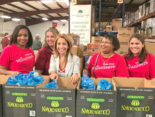 Wells Fargo volunteers were happy to participate in the 2017 Pack the House. The company is the presenting sponsor for this year's two-day event.