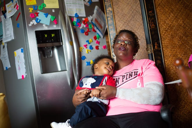 Pamela Turner is a disabled Navy veteran, cancer survivor, former corrections officer and single mother of four. Her foster son, Marc Turner Jr., 1, vies for her attention during an interview Oct. 9, 2018, at her home in Fort Pierce.
