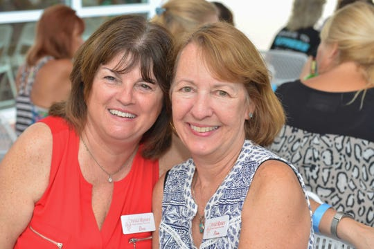 Bea Swanson, left, and Pam Bellingham at the Wild Roses Foundation's Rose Buds & Country Studs workshop at River Walk Center in Fort Pierce.