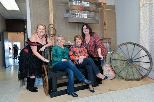 Wild Roses Foundation's Board Vice President Dee Dee Maynard, Dale French, Faye Hawley and Terri Shipley at the Rose Buds & Country Studs workshop at River Walk Center in Fort Pierce.