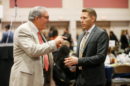 County Judge Ruben John Vogt speaks with El Paso Mayor Dee Margo shortly before giving his first and only State of the County address Wednesday afternoon at the El Paso convention center. Vogt spoke about his time as county judge and the accomplishments he's been able to make during his short time in office.