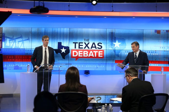 U.S. Rep. Beto O'Rourke, D-El Paso, left, faces U.S. Senator Ted Cruz, R-Texas, in debate at the KENS 5 Studios in San Antonio on October 16, 2018.