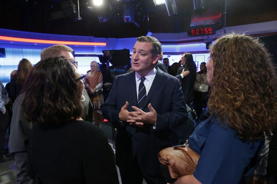 U.S. Sen. Ted Cruz, R-Texas, center, visits with guests following a debate for the Texas U.S. Senate with U.S. Rep. Beto O'Rourke, D-Texas, Tuesday, Oct. 16, 2018, in San Antonio. (Tom Reel/San Antonio Express-News via AP, Pool)
