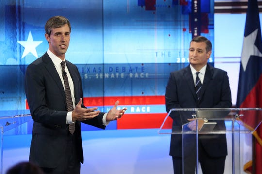 U.S. Rep. Beto O'Rourke, D-El Paso, left, and U.S. Sen. Ted Cruz, R-Texas, take part in a debate for a Texas U.S. Senate seat Tuesday, Oct. 16, 2018, in San Antonio.