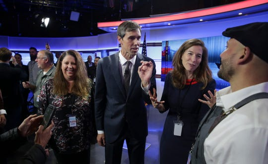 U.S. Rep. Beto O'Rourke, D-El Paso, center, visits with guests following a debate for a Texas U.S. Senate seat with U.S. Sen. Ted Cruz, R-Texas, on Tuesday, Oct. 16, 2018, in San Antonio.