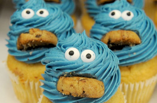 Cookie Monster cupcakes are seen at Camarillo Cupcake, opened this spring by home baker turned pro Gina Stymacher. In addition to its core flavors, the shop introduces a new batch of limited-time-only flavors every Thursday. Gluten-free and vegan options are included.
