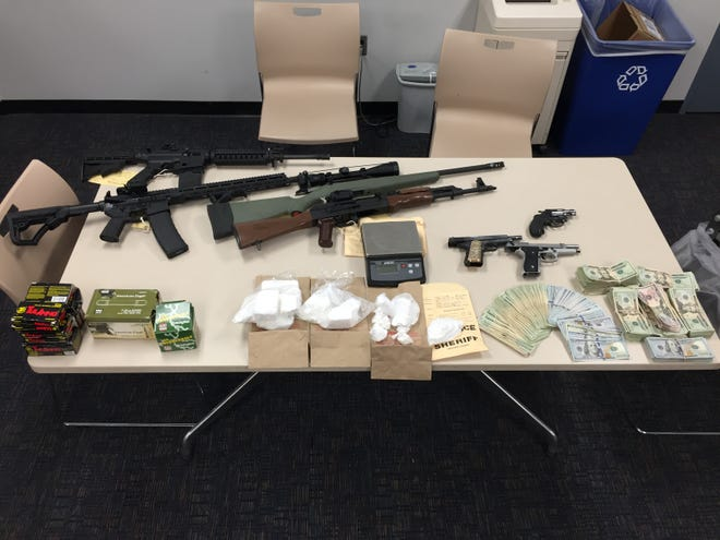 Guns, including an AK-47, cocaine and cash were seized Monday in El Rio after an investigation into cocaine sales by the Ventura County Sheriff's Office.