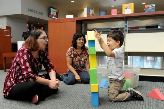 Joanne Center, right, a children's librarian and Maria Mendez watch her grandson Brian Alexander Dewey play with blocks at the South Oxnard Library. The  libraries 1, 2, 3 workshops program teaches parents how to be involved with their children.